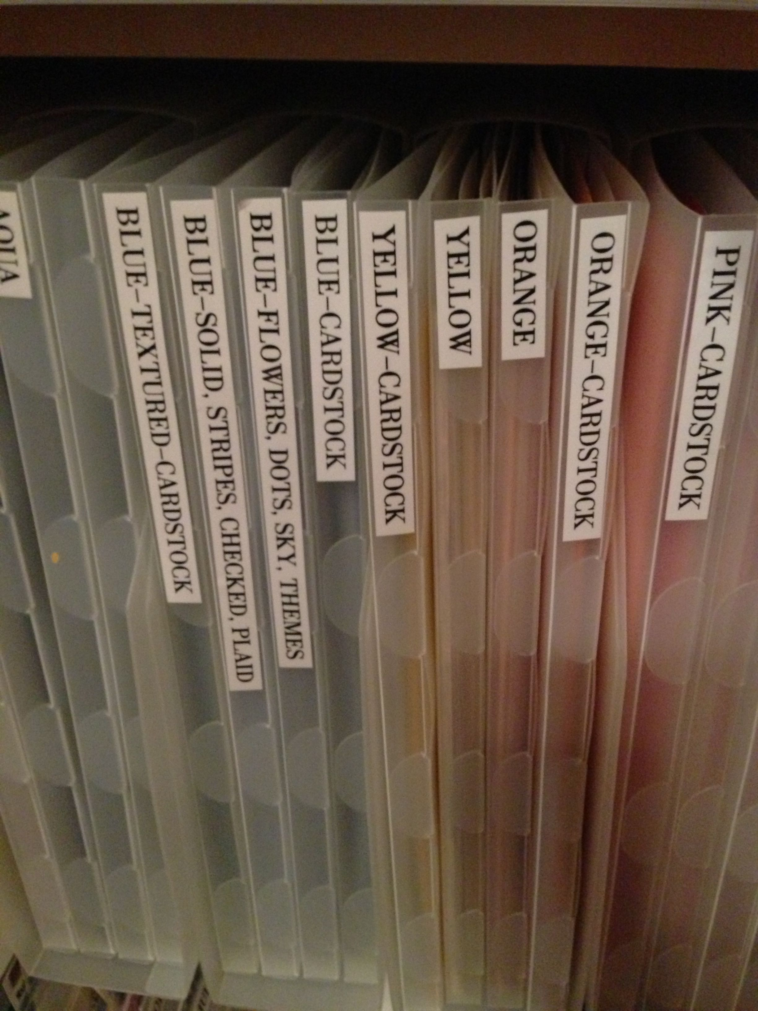 Organizing scrapbook paper by color, weight and theme