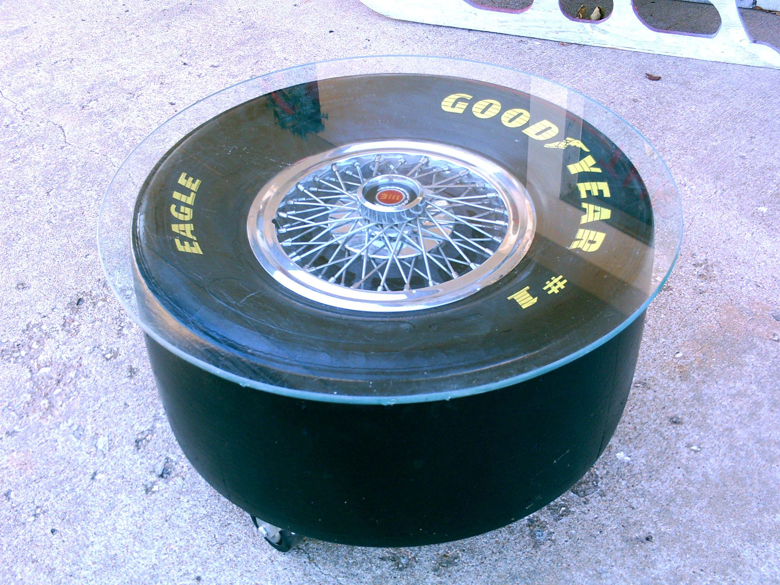 Great man cave coffee table made from a racing slick a Cadillac