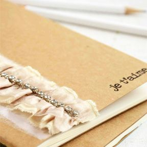 embellished journal idea. stitch down center of trim w/ heavy gauge needle.