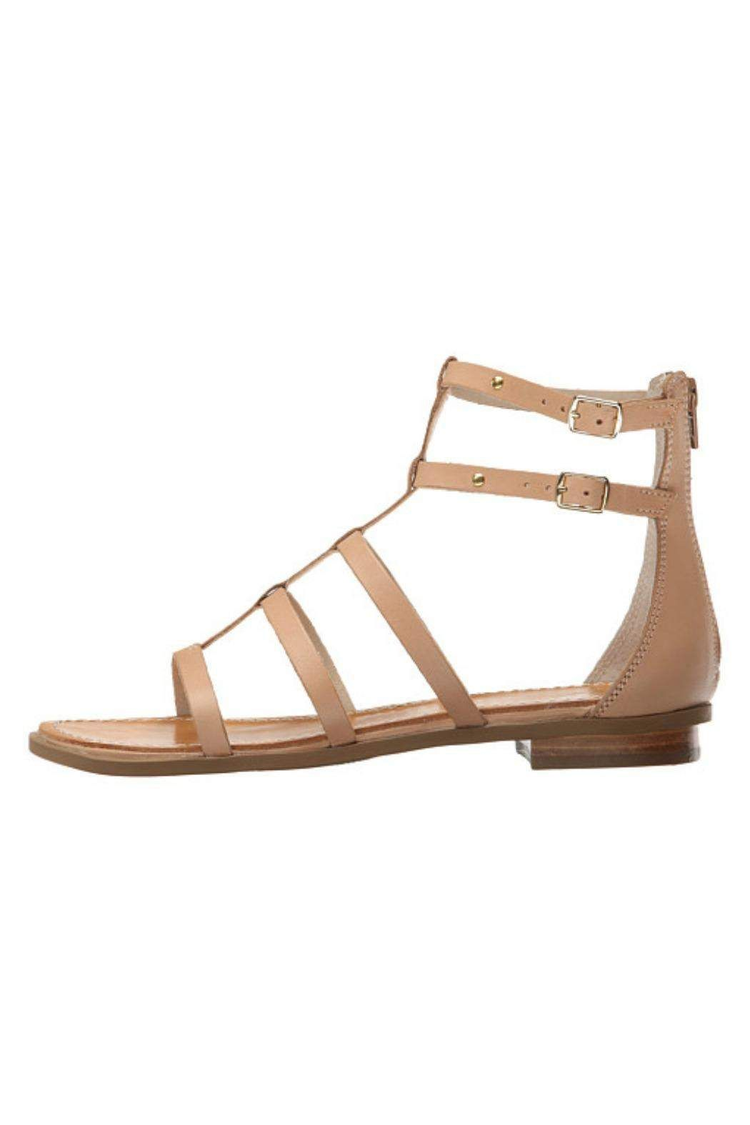 557ef37a9355 Back zipper closure. Double ankle straps with adjustable buckles. Caged  open toe silhouette.