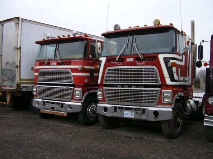 A pair of Ford CL 9000 trucks