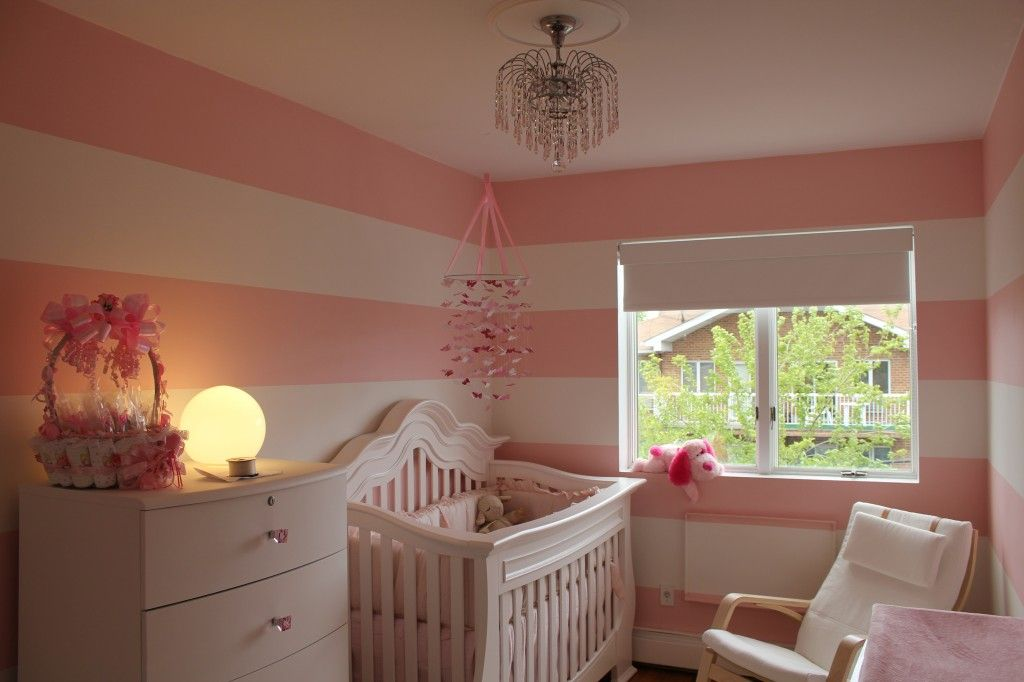 This pink and white striped nursery is so sweet and feminine.
