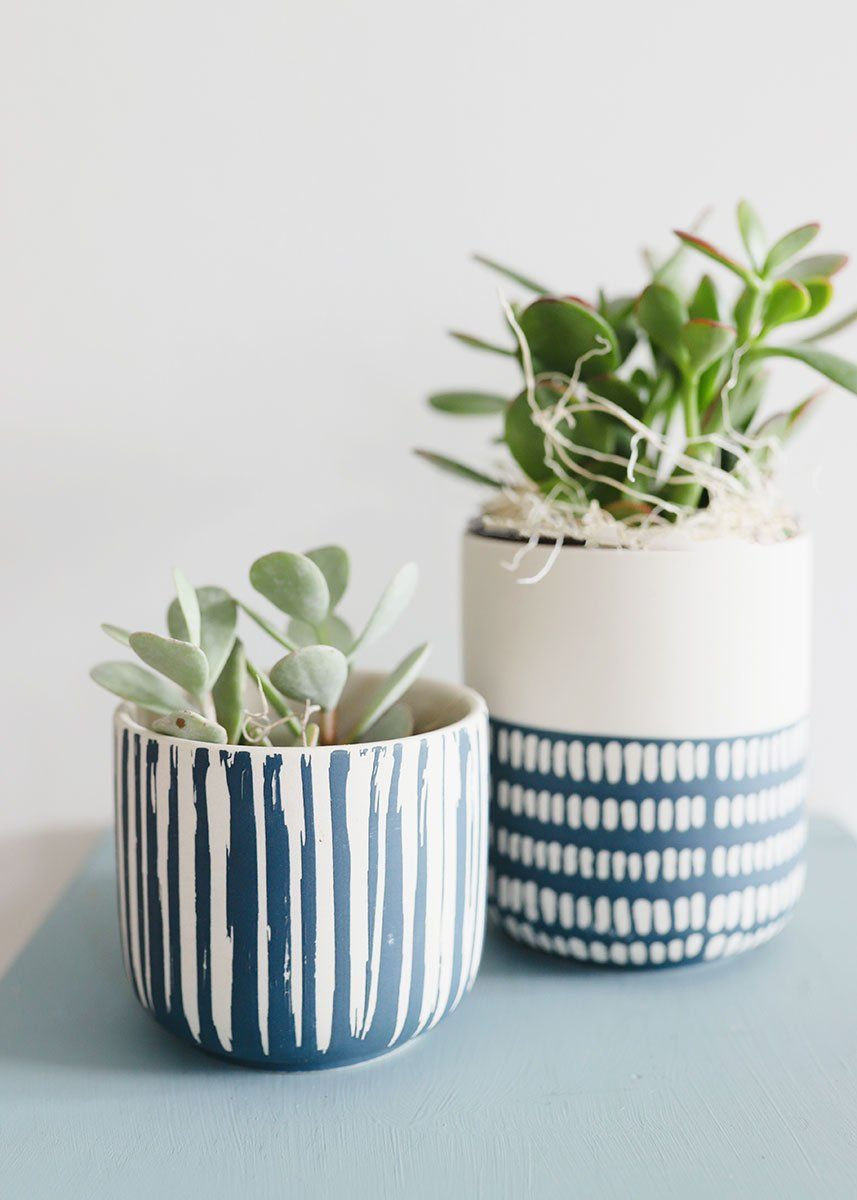 Find cute and trendy table vases for your home decor, like this stoneware flower pot from the Westview Collection. It's white, and the bottom half is painted blue and has a geometric dots pattern.  Blue and White 5