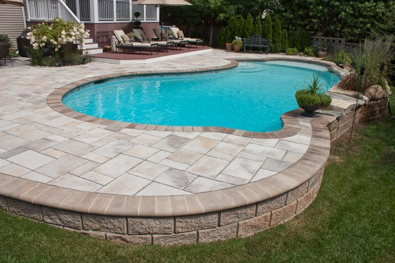Love this pool deck semi inground pools pinterest for Pool design sloped yard