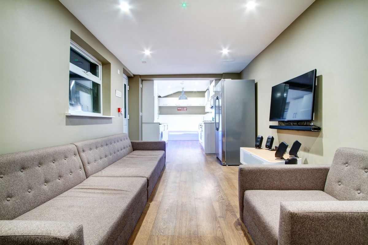 Modern living room with a built in TV and built surround sound 61