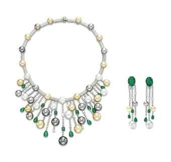ELIZABETH TAYLOR , A SET OF DIAMOND, EMERALD AND CULTURED PEARL JEWELRY, BY HOUSE OF TAYLOR Comprising a necklace, the front suspending a circular-cut diamond fringe set with multi-colored cultured pearls and variously-shaped emeralds, to the pavé-set diamond and multi-colored cultured pearl band; and a pair of ear pendants en suite, mounted in 18k white gold 16 ins. Each signed Elizabeth for House of Taylor $242,500.00