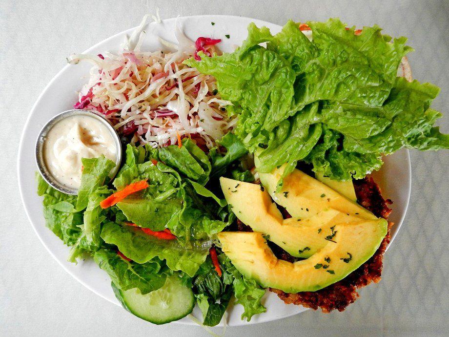 More great food on the Big Island: the macadamia-nut veggie burger (buried under avocado) at the Kona Coffehouse & Cafe in Honaunau.