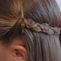 Uneven 3 strand braid. Middle strand fat, two outside skinny..cool idea