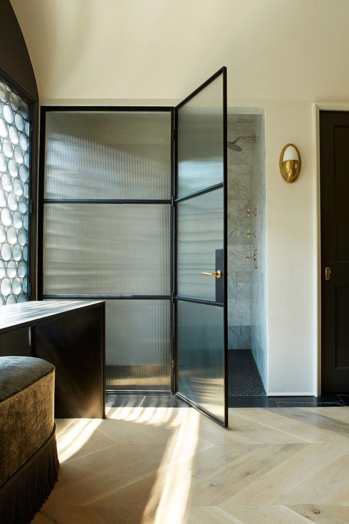 Fluted Panels In The Master Bath S Custom Steel Shower Doors And