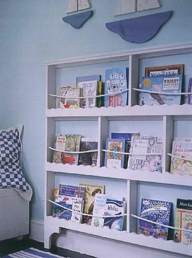 This nautical bookcase displays books and magazines behind decorative trim rope the theme makes it especially fun in  kid   room also madison shelf bookrack pottery barn kids wide  deep