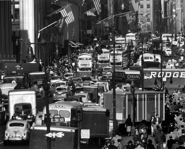 Typical crowded urban scene in Midtown Manhattan looking north on 5th Ave from 31st Street.  Location:	New York, NY, US  Date taken:	1948