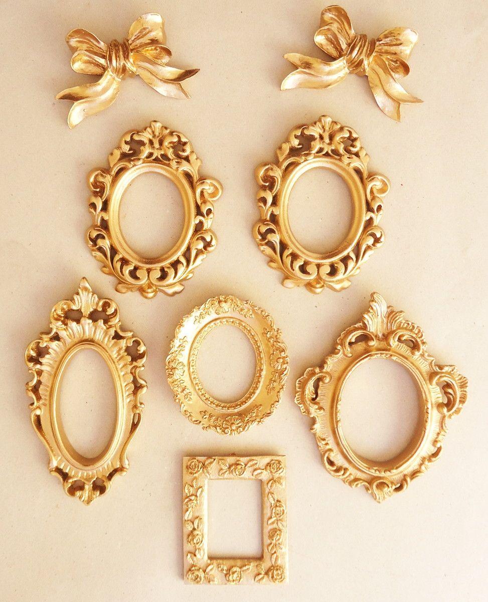 molduras de resinas ouro com laço