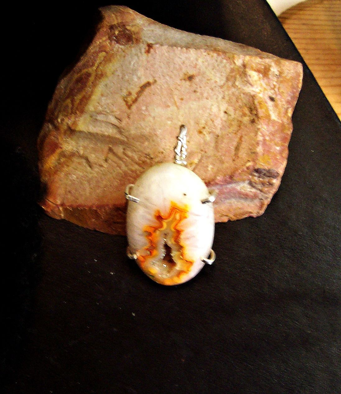 Beautiful white with orange druzy captured in solid sterling silver. Measures 1 1/2 in x 1 1/4 in.
