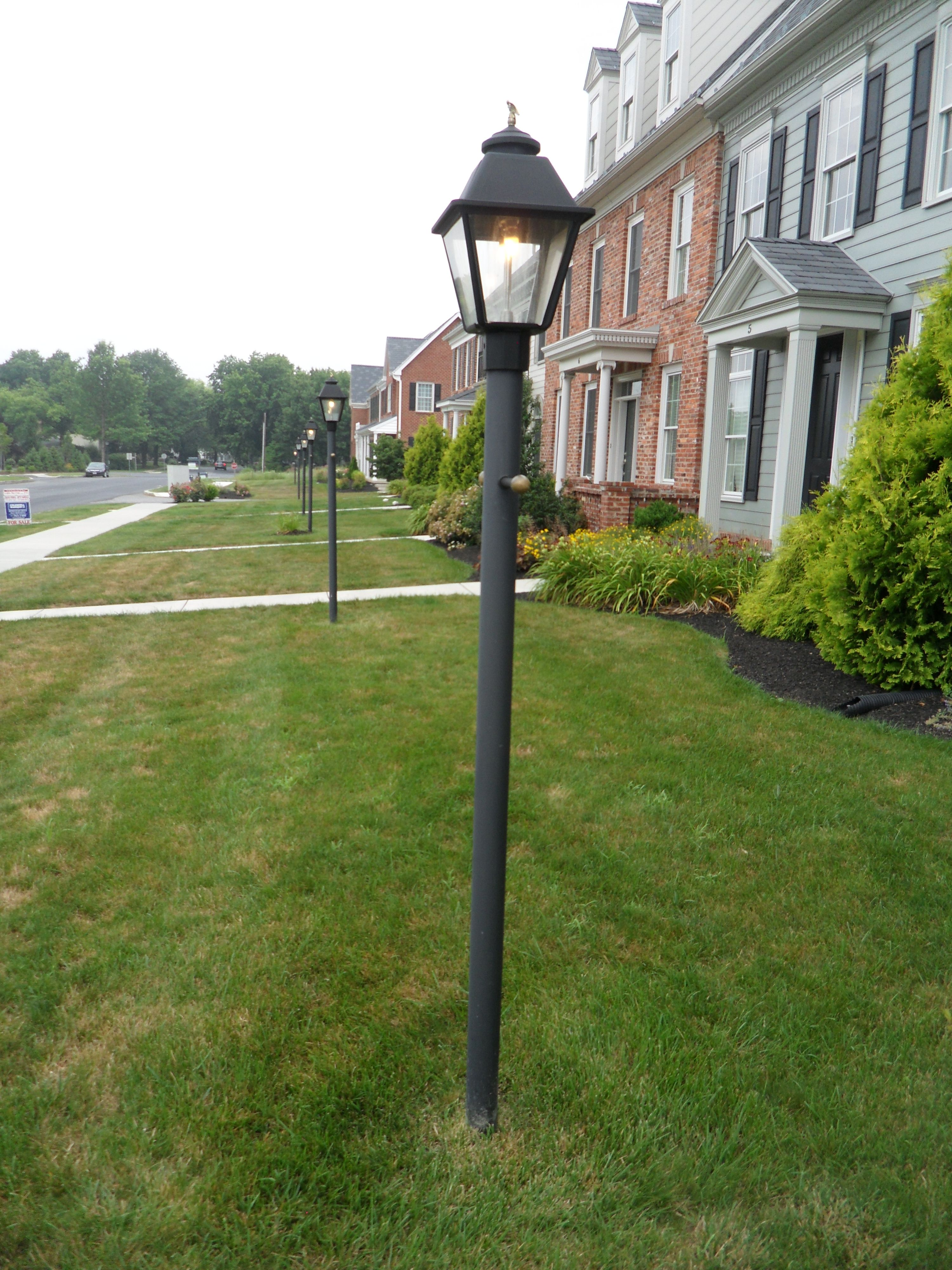 Post Mounted Westmoreland D Lamps With Dual Inverted Gas Mantle Burners And Small Eagle Finials Light Up The Jamestown Square Neighb Gas Lanterns Gas Lamp Lamp