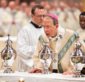 Archbishop Lori breathes the Holy Spirit in the holy chrism