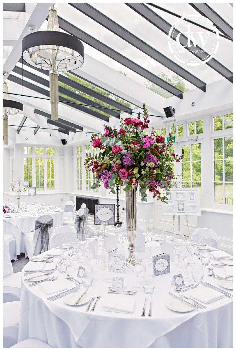 Barn wedding table settings  Wedding reception decor at Paddocks House Newmarket  Wedding