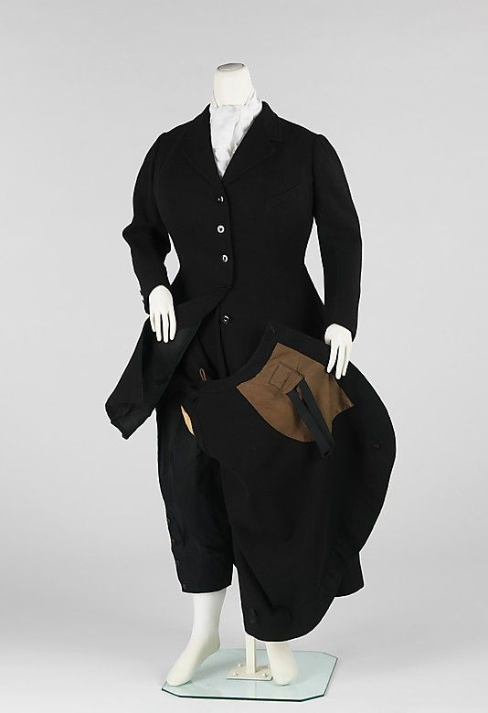 """Riding Habit: Dertz, 1909, American, wool/cotton. """"This beautifully made riding habit includes both jodhpurs and a skirt. The riding skirt by this date has become slender and the inclusion of jodhpurs underneath can be seen as a sign of the transition between the modesty of the voluminous 19th century side saddle skirt to the modern riding pants style that would dominate by the 1920s. It marks the end of side saddle riding for women and to the impropriety of jodhpurs and a beginning of a…"""