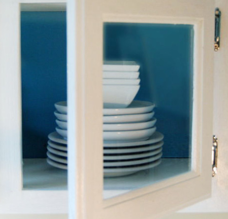 Replace The Panels Of Your Kitchen Cabinets With Glass For An Easy