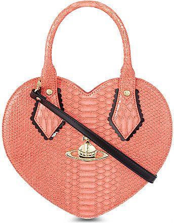 6284ff496ed Vivienne Westwood Frilly snake-print heart bag on shopstyle.co.uk ...