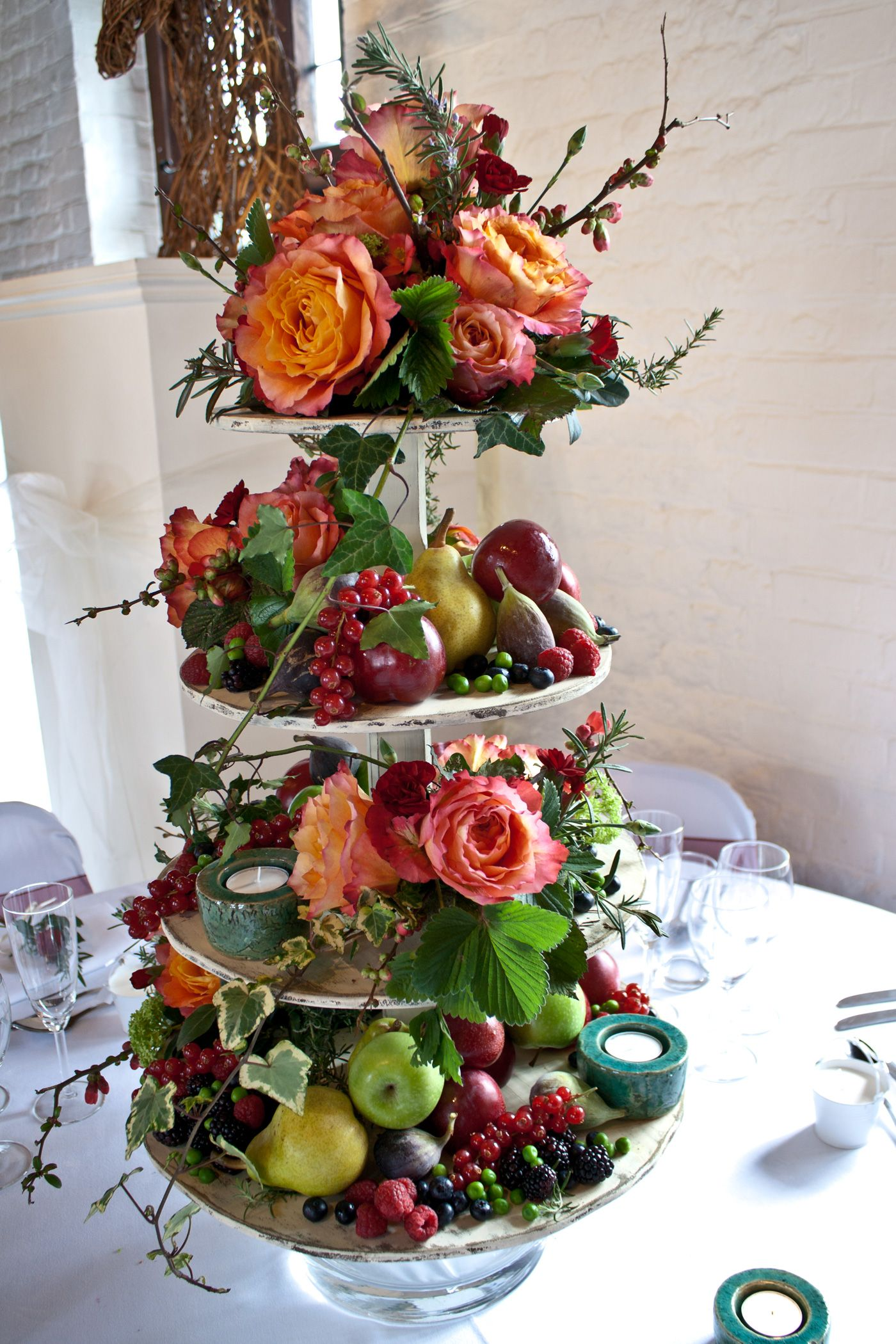 Flowers And Fruit Wedding Table Centre Cup Cake Stand In Hot Colours Ideal For The Summer Weddi Fruit Centerpieces Wedding Table Decorations Diy Fruit Wedding