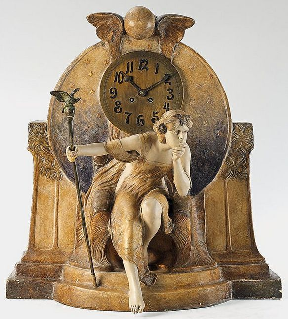 Art nouveau clock - A Vienna gilt ceramic Théodora figure clock. A Goldscheider gilt and painted terracotta and bronze table clock, the movement with half hour strike on spiral gong - Ca. 1903.