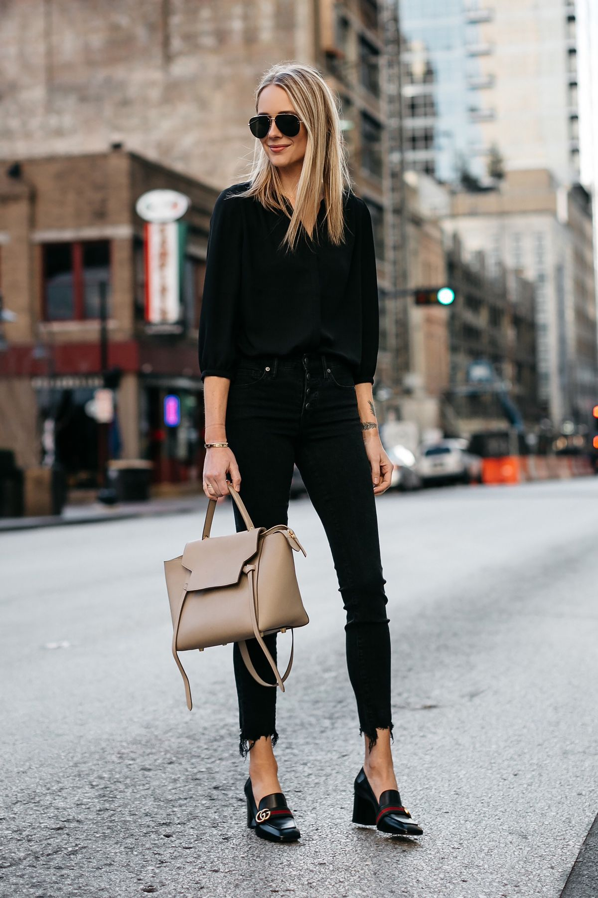 fffab542b24d Blonde Woman Wearing Black Shirt Madewell Black Ripped Hem Skinny Jeans  Gucci Black Peyton Block Heel