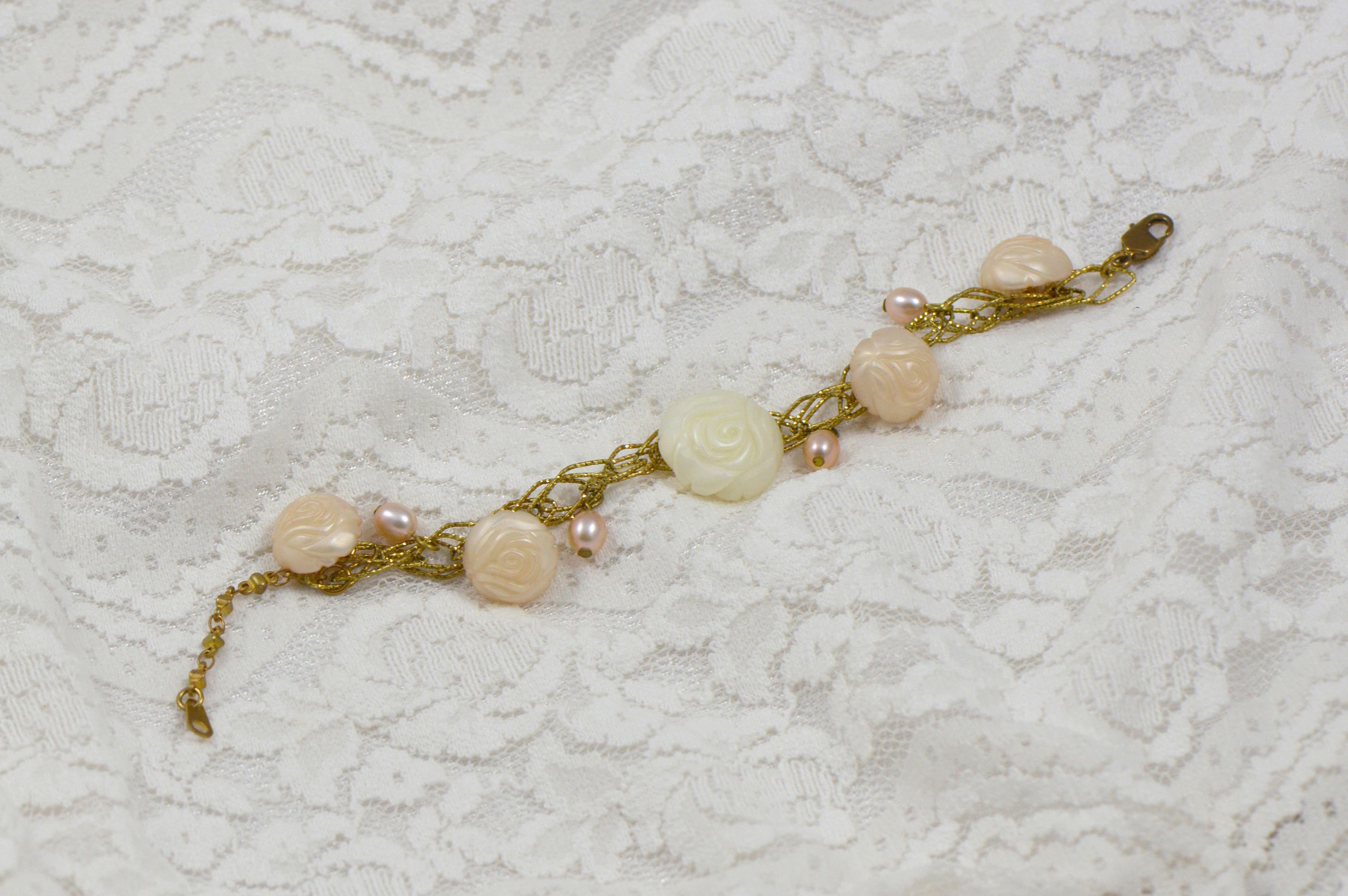 An luxury bracelet made of elegant antique rose buttons and pink
