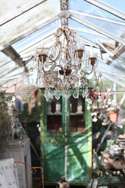 The greenhouse love the chandelier in here the old green cabinet the greenhouse chandelier aloadofball Images