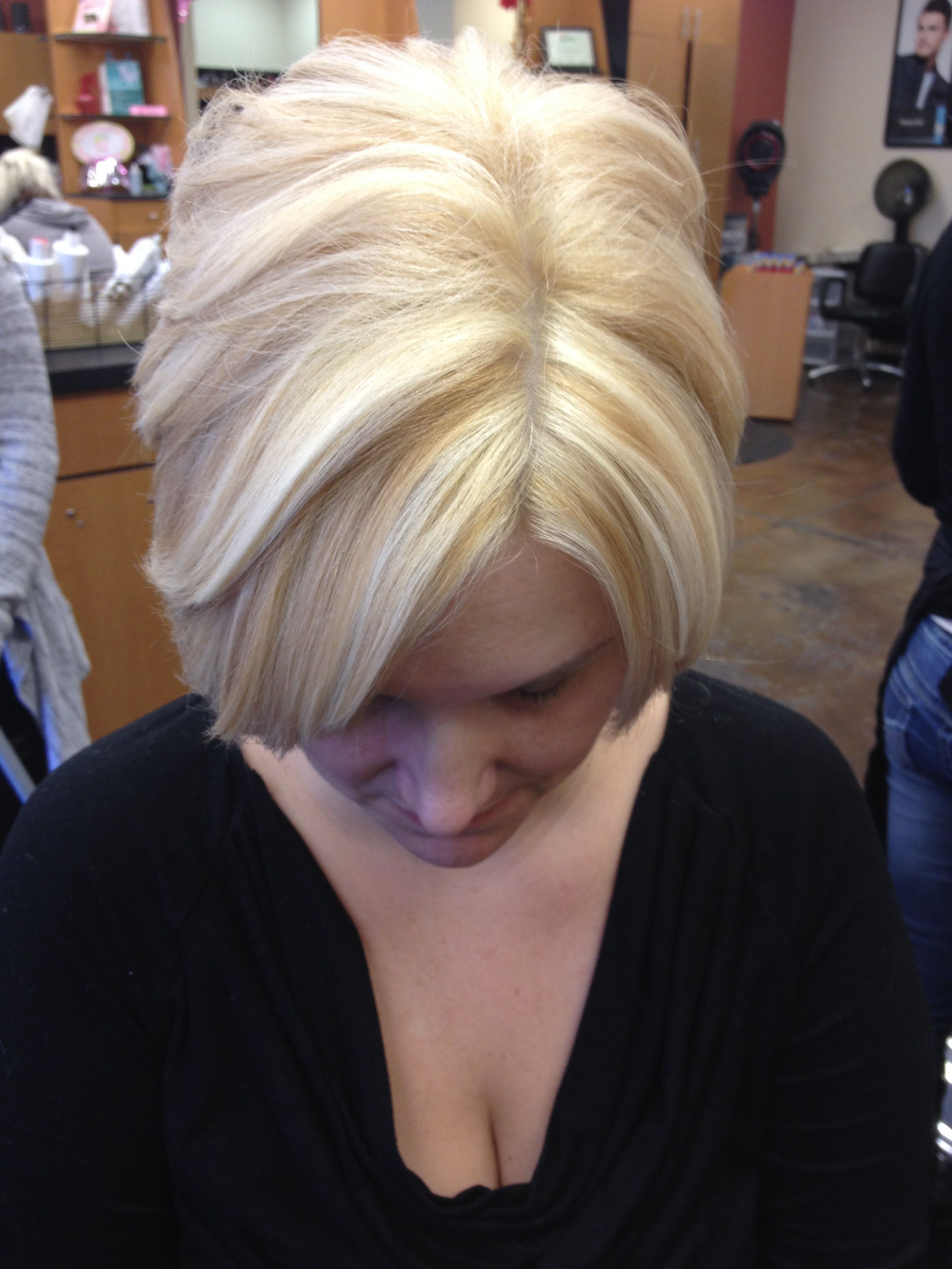 Short bob platinum base with golden blonde lowlights and blonde