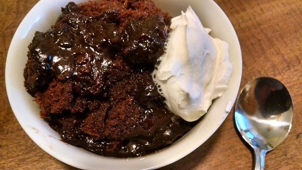 Crock-Pot Brownie Pudding - This recipe for Crock-Pot Brownie Pudding could not get any easier to make. A boxed brownie mix and instant pudding is cooked together for a ooey gooey chocolate dessert! | CrockPotLadies.com