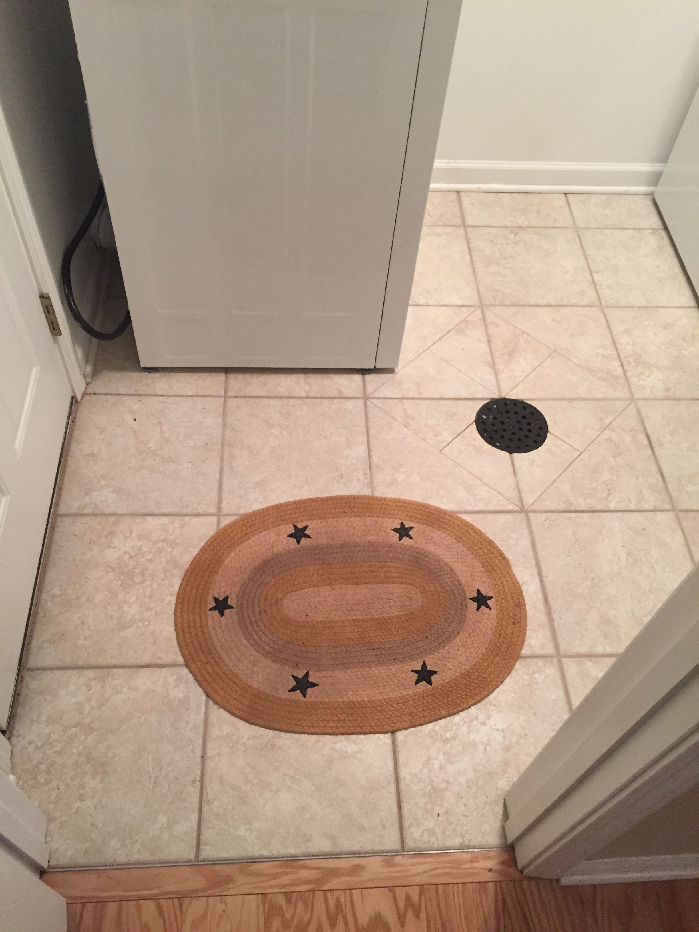 Tile Mud Room With Floor Drain