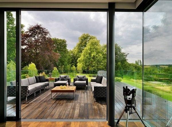 Terrace modern decor wood plank floor sunbeds house rent gray