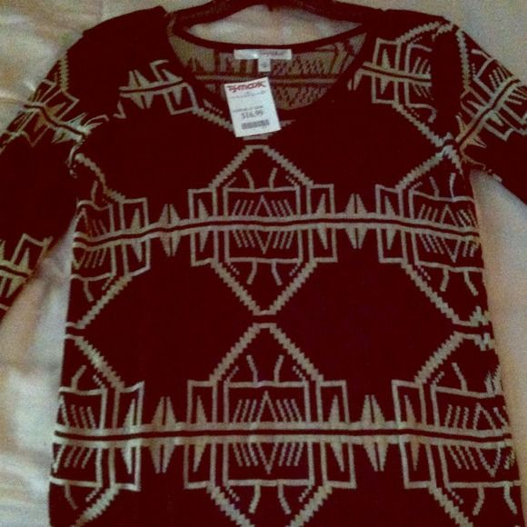 Sweater shirt This is a sweater top, long to wear with leggings. New never worn. Medium. Black with tan print. Sweaters