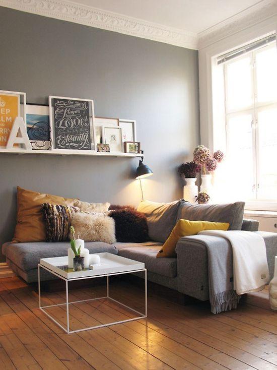 Grey sofa and walls with camel floor and pillows. Nice balance ...