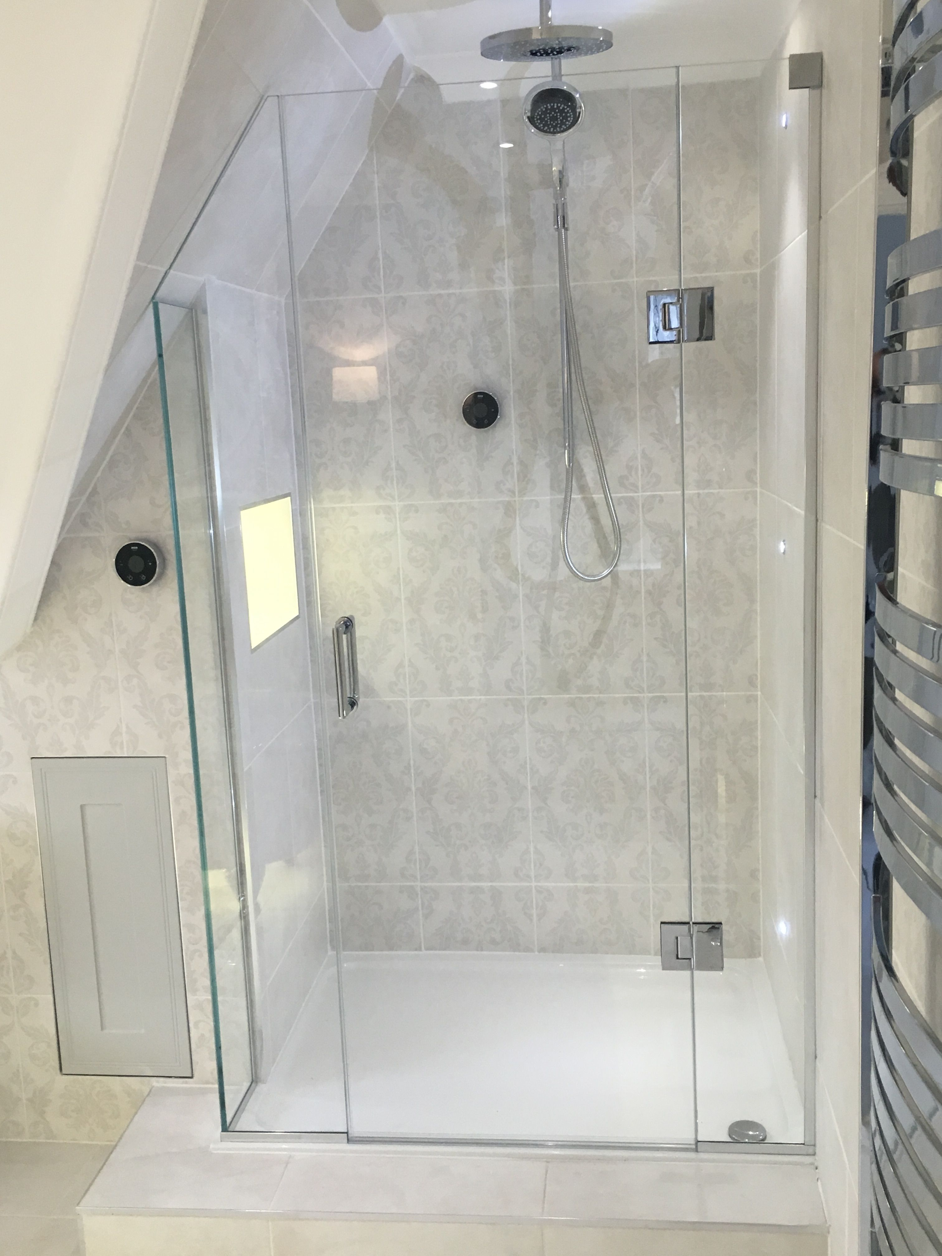Frameless Shower Enclosure shaped to sloping roof with bonded return ...