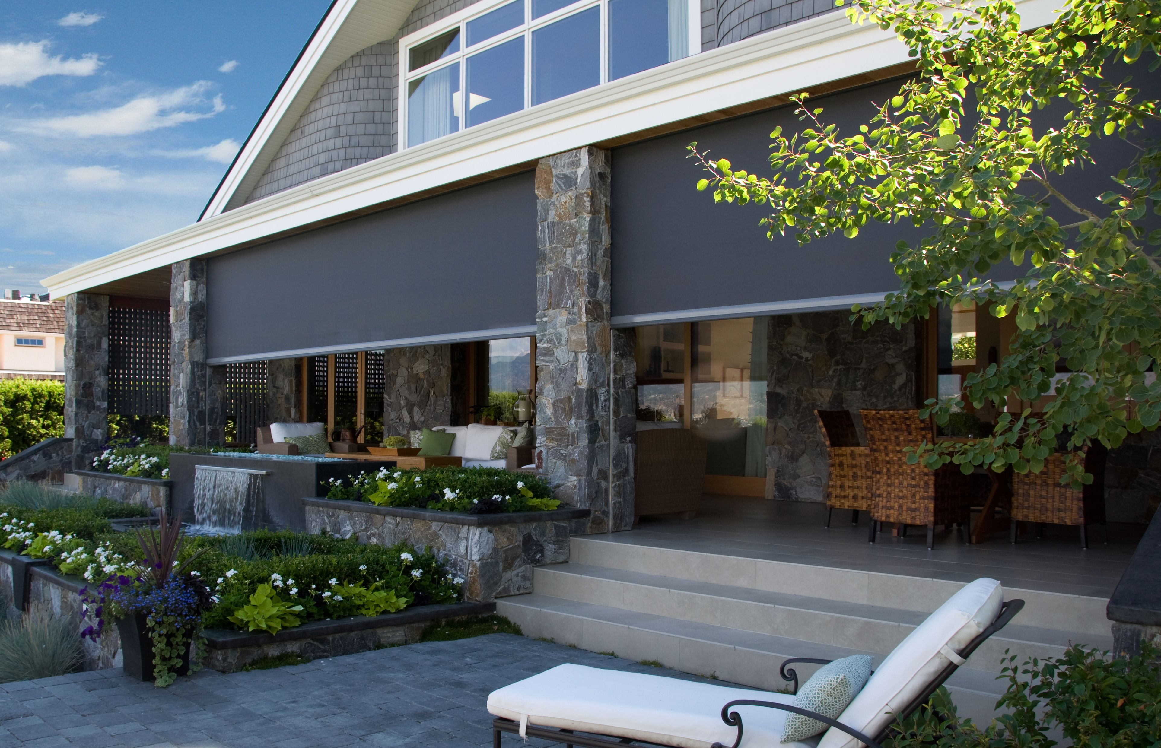 Motorized retractable patio screens roll up patio