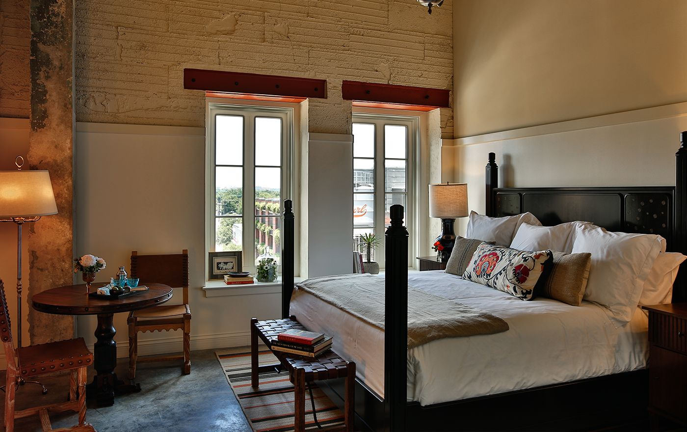 Picture Of The Classic Brewhouse King Room Option King Size Bed Is Decorated With A White Throw And Warn Color Hotel Emma San Antonio Hotel Emma Elegant Homes