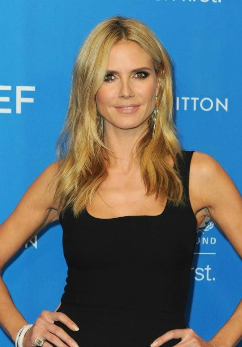 heidi klum looked gorgeous and stylish as ever in a figure hugging black dress that showcased. Black Bedroom Furniture Sets. Home Design Ideas