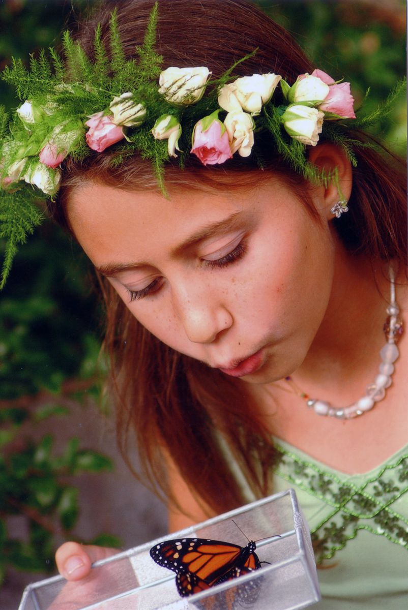 Flower girl releasing butterflies at wedding at San Diego