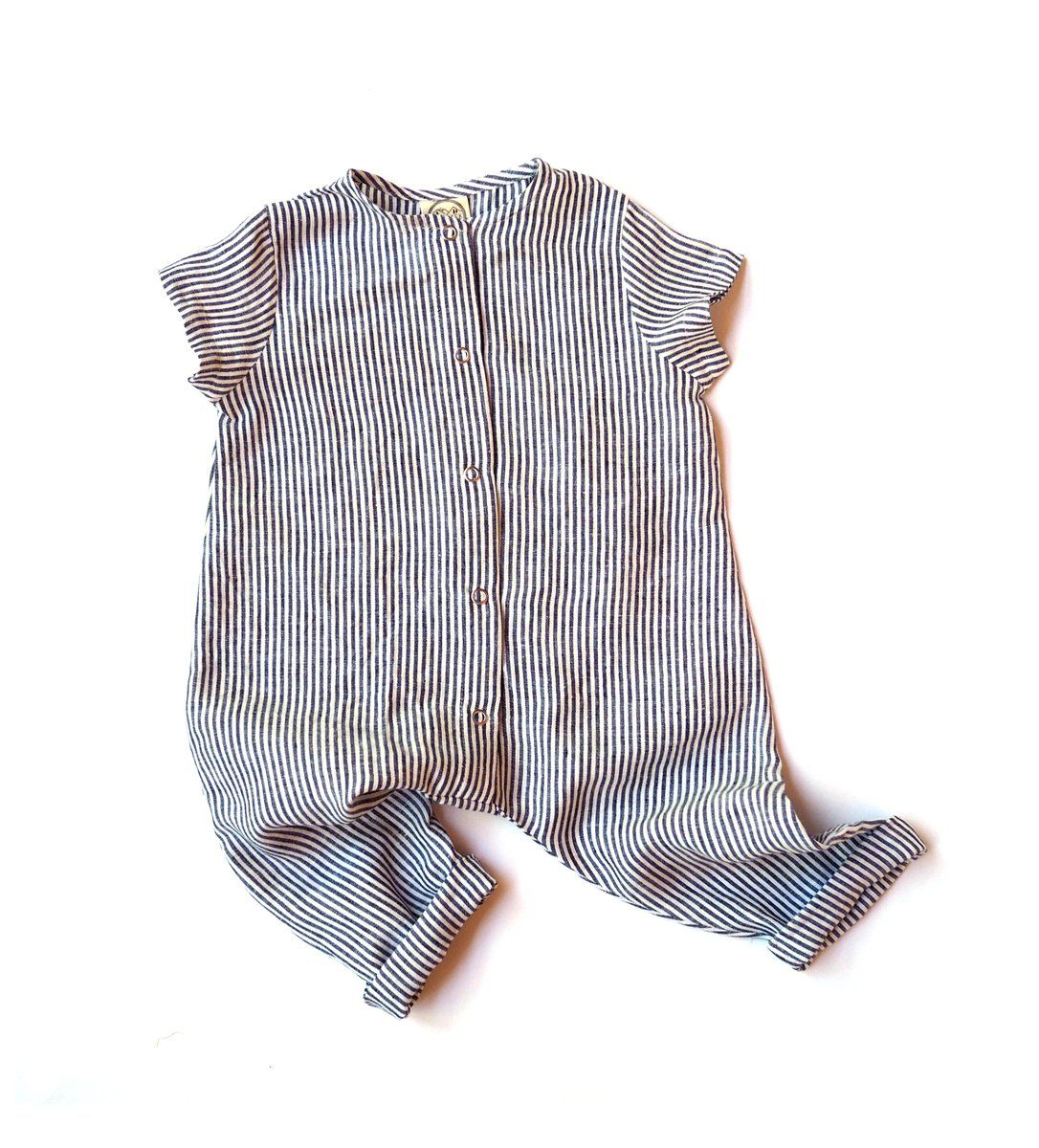 A Short Sleeve Slip On Jumpsuit With Bias Binding On The