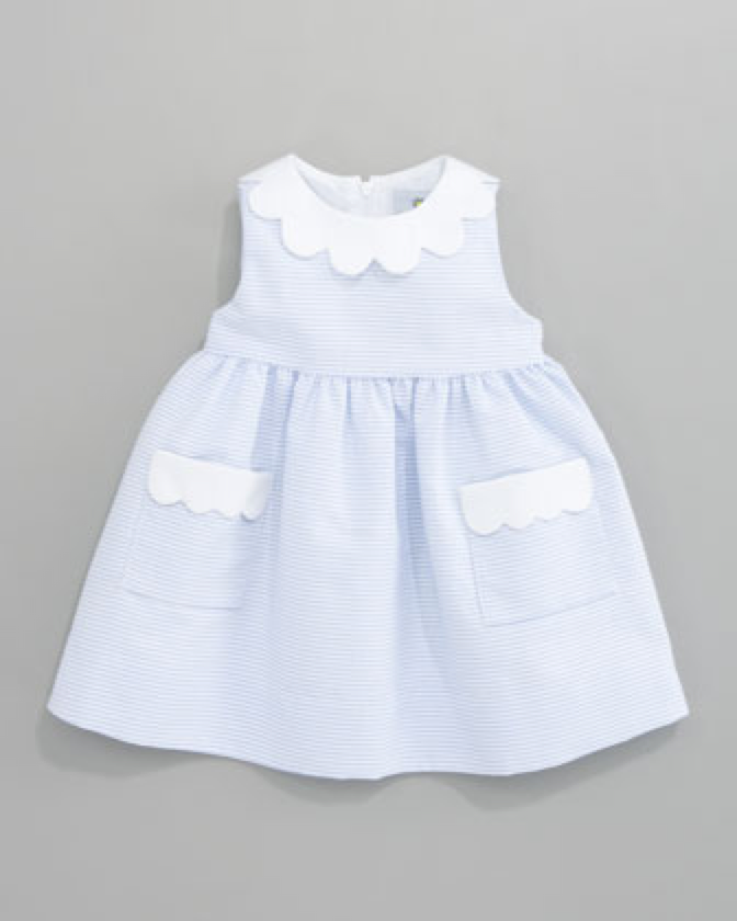 Girls dress with white scalloped detailing.