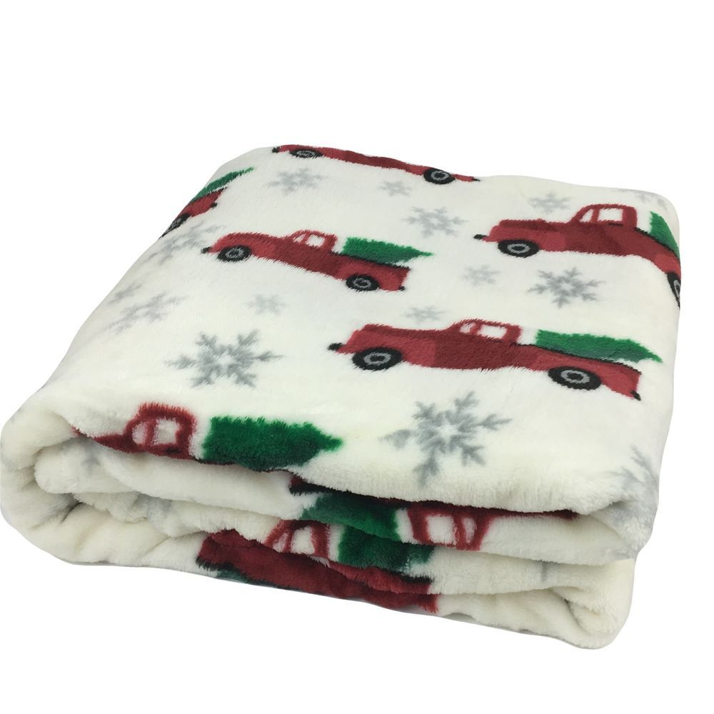 . This Cream Colored Throw Is Accented With Country Style