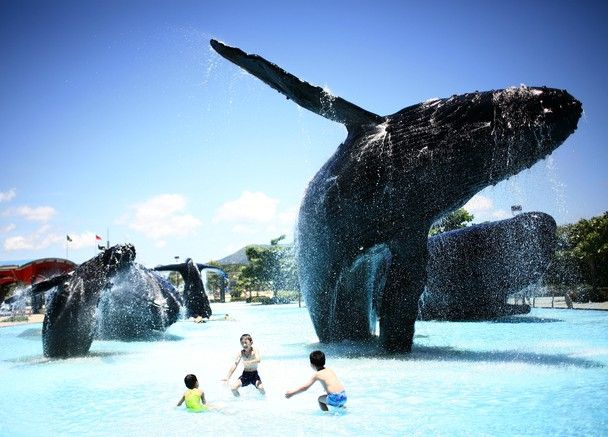 Children enjoy themselves with the actual size whale sculptures in the National Museum of Marine Biology and Aquarium in summer heat in southern Taiwan. Picture taken in Pingtung, June 30, 2011