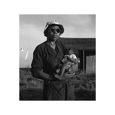 "Buyenlarge 'Wife and Child of Tractor Driver' by Dorothea Lange Photographic Print Size: 66"" H x 44"" W"