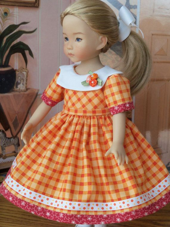 """RESERVED for SALLY Orange Blossom Dress for Dianna Effner's 13"""" Little Darlings. I love the oranges and pinks on this cotton dress. Fully lined bodice, flutter sleeves banded with the same contrasting fabric as the band on the hem. A band of grosgrain ribbon tops the contrasting hem trim. The lovely white scalloped collar is adorned with a trio of satin flowers."""