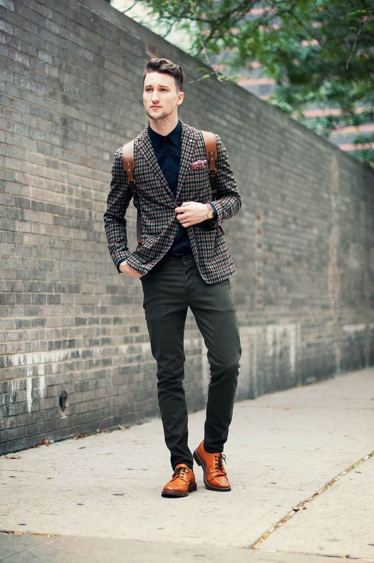 Pair a navy and white plaid blazer with olive chinos to create a smart casual look. This outfit is complemented perfectly with orange leather brogues.  Shop this look for $277:  http://lookastic.com/men/looks/longsleeve-shirt-and-pocket-square-and-blazer-and-chinos-and-brogues-and-backpack/760  — Navy Longsleeve Shirt  — Burgundy Pocket Square  — Navy and White Plaid Blazer  — Olive Chinos  — Orange Leather Brogues  — Brown Leather Backpack
