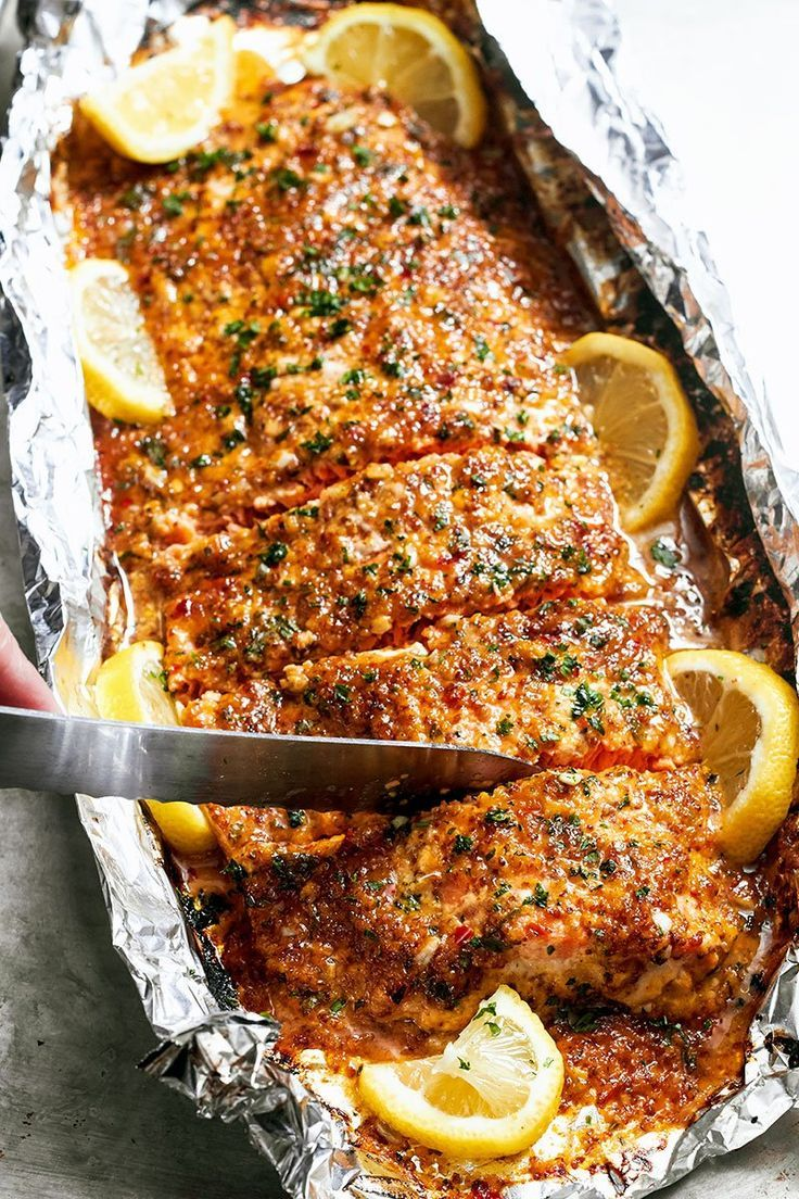 Baked honey garlic salmon in foil seafood dinner garlic for Fish dishes for dinner