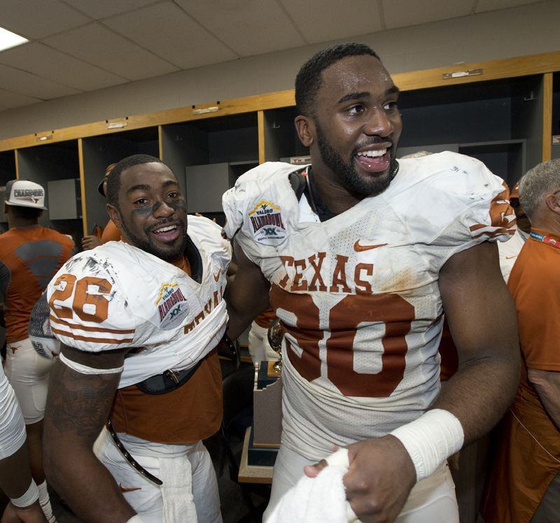 acf761776 D.J. Monroe (26) and Alex Okafor (80) celebrate the Longhorns  Alamo Bowl  victory in the locker room.