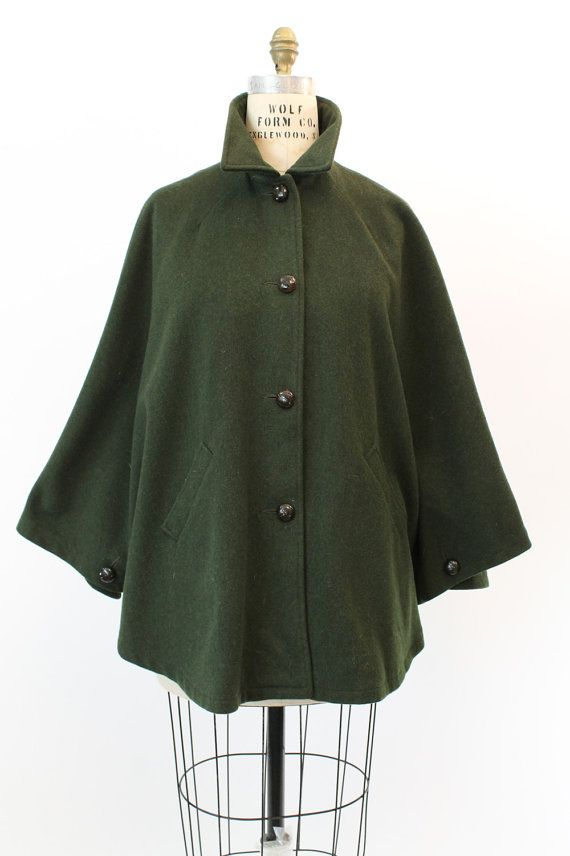 8b4a8a66320 Classic Eddie Bauer cape! Done in deep loden green wool with paisley  lining. With front braided large buttons