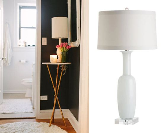 Elegant White Glass Table Lamp On A Small Tripod Table With Bamboo Legs In  A Corner